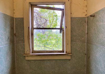 abandoned farmhouse bathroom window