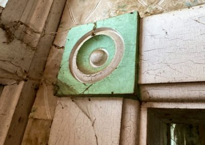 farmhouse woodwork green trim around doors