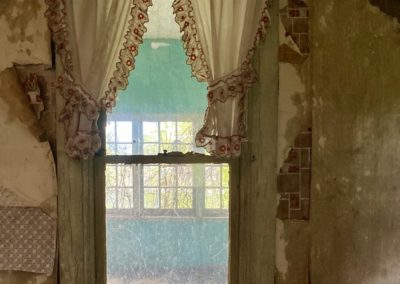 abandoned house with curtains