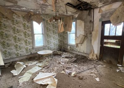 abandoned farmhouse living room
