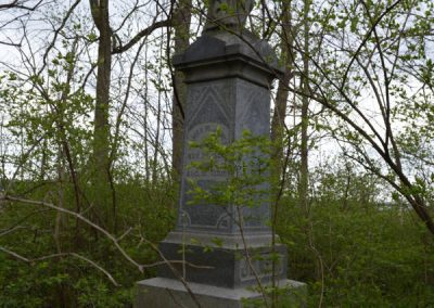abandoned cemetery monument overgrown and forgotten