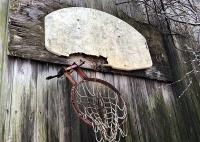 abandoned basket ball hoop with broken rim