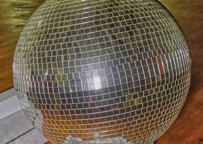 huge disco ball in skating rink