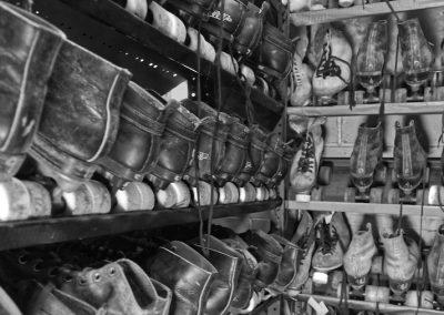 abandoned roller skates on shelves at skateland