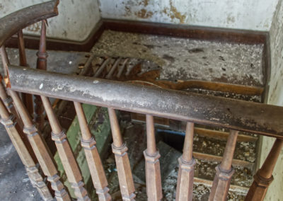 abandoned victorian mansion hand rail
