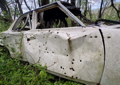 car-riddled-with-bullet-holes