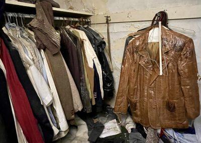 abandoned mens closet full of clothing