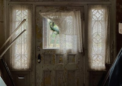 abandoned colonial revival front door close