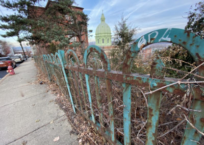 abandoned catholic school fence