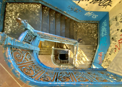 abandoned school blue staircase round looking straight down