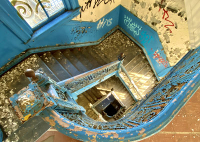 abandoned school blue staircase round looking down