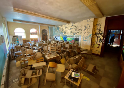 room of desks abandoned catholic school