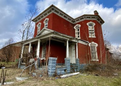 victorian style house abandoned front red brick