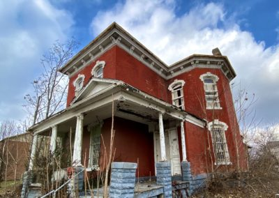 victorian style house abandoned front view