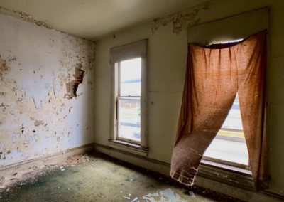 victorian style house abandoned blowing curtains