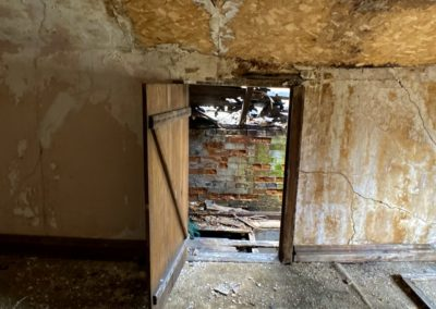 victorian style house abandoned attic door open