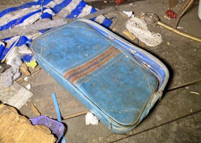 abandoned blue stripe suitcase vintage