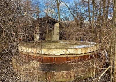 concrete round farm outhouse cistern