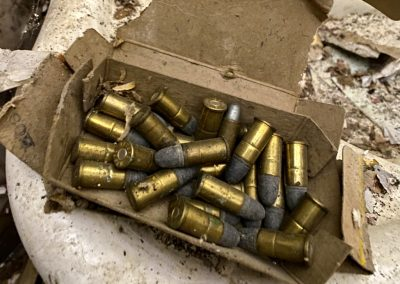 abandoned colonial house found bullets
