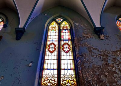 tall-stained-glass-window-abandoned-church