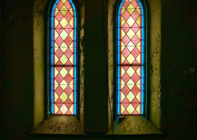 abandoned-church-two-stained-glass-windows