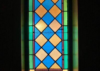 green-orange-blue-leaded-stained-glass-window