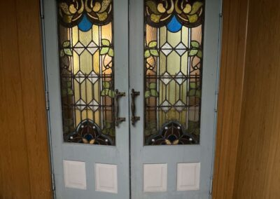 double-doors-with-stained-glass-abandoned-church