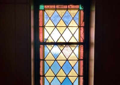 green-yellow-blue-leaded-stained-glass-window