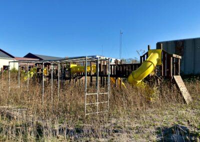 abandoned-school-wood-playground-slide-2