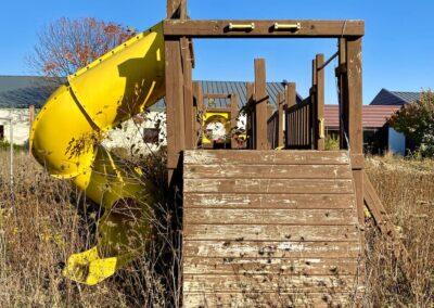 abandoned-school-wood-playground-slide