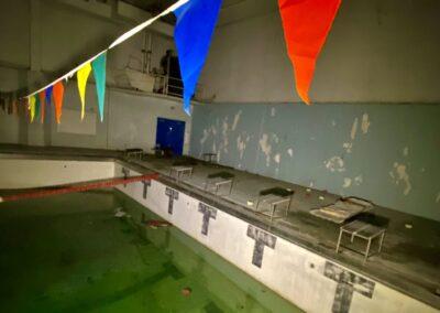 abandoned-ymca-pool-flags-across