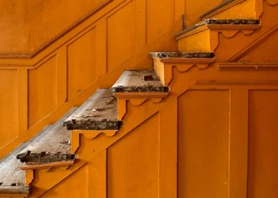 orange staircase in a colonial house