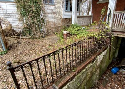 colonial house rot iron fence
