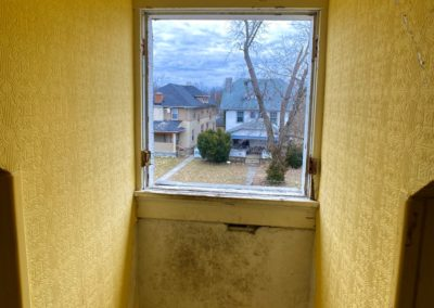 looking out of a colonial houses window