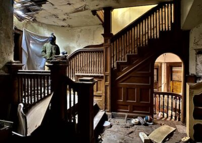 grand-victorian-staircase-inside-abandoned-house