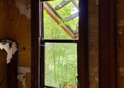 abandoned-house-victorian-window-looking-out
