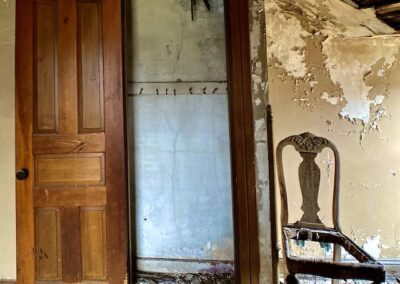 abandoned-house-bedroom-chair-by-window