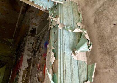 paint-peeling-off-blue-trim