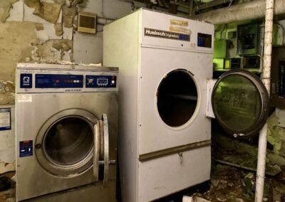 abandoned-commercial-washer-dryer-in-basement