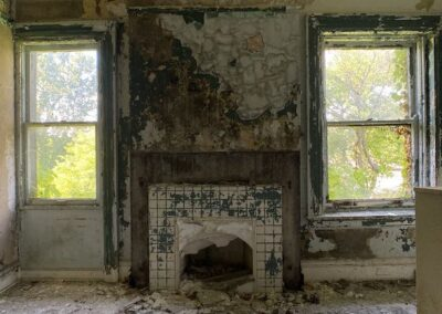 abandoned-victorian-mansion-fireplace-windows