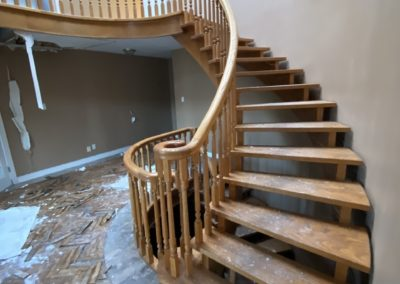 abandoned-mansion-wood-curved-staircase