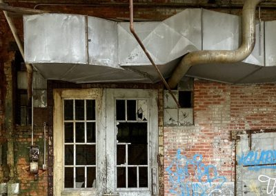 abandoned-factory-tall-doors