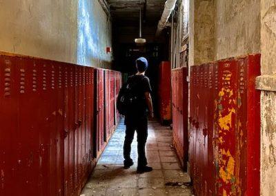 abandoned school hallway red lockers