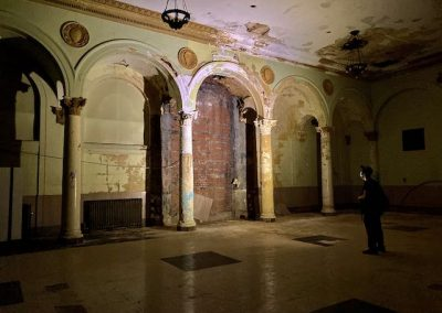 abandoned auditorium with arches