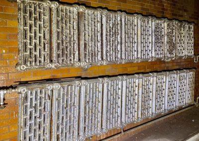 vintage radiators covering wall of pool