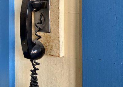 vintage school phone hanging on wall