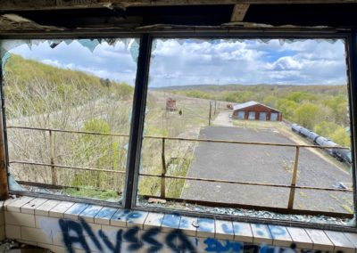 looking-out-of-abandoned-train-control-tower