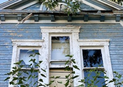 abandoned-victorian-house-front-attic-window