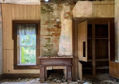 abandoned victorian mansion fire place