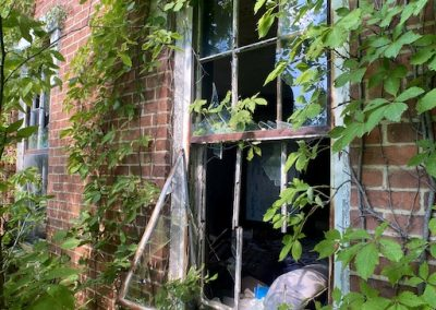 abandoned victorian mansion front window